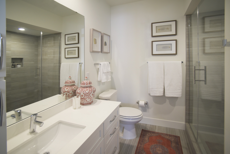 Spur 16 apartments showcase their modern bathroom and beautiful shower.