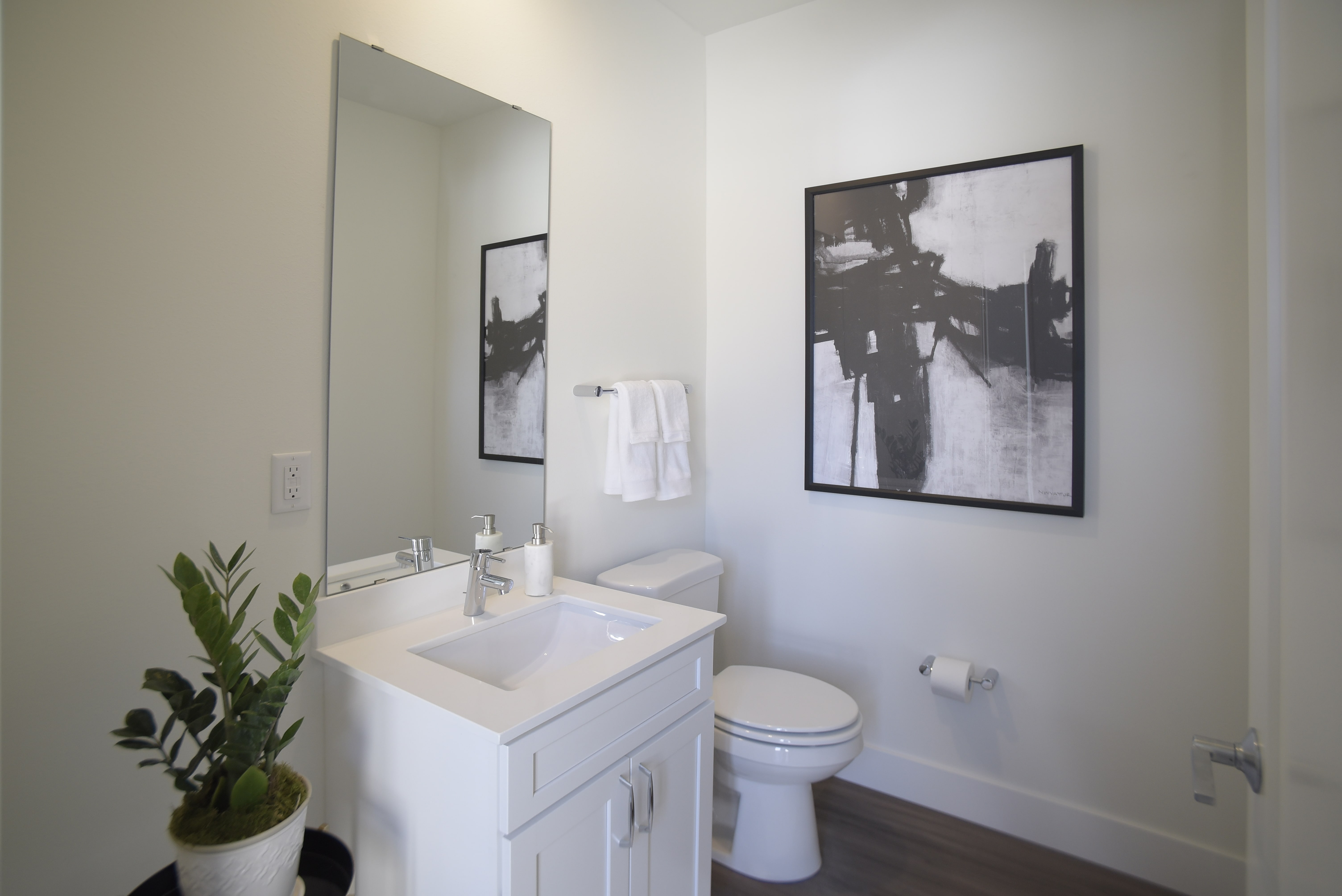 Spur 16 Apartments provide beautiful wood flooring in the bathroom.